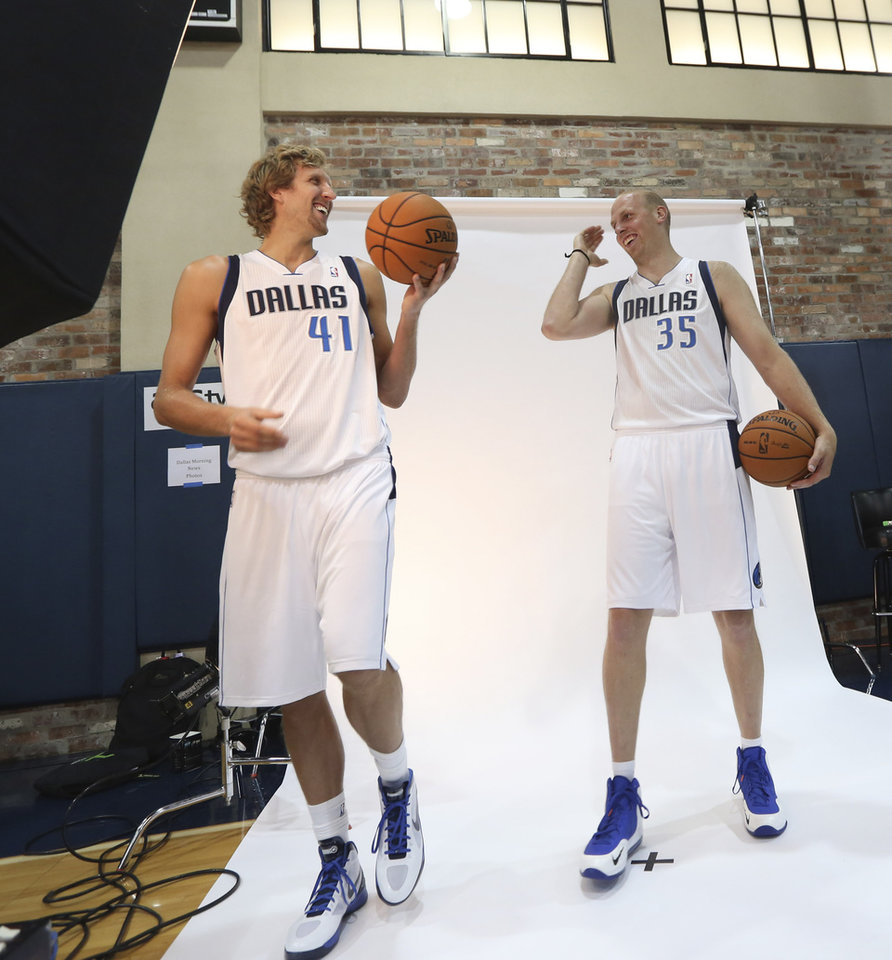 **CORRECTS DAY TO FRIDAY** Dallas Mavericks Dirk Nowitzki of Germany. left, laughs with new teammate Chris Kaman between photos during the team's media day Friday Sept. 28, 2012, in Dallas. Nowitzki again has a lot of new teammates with the Mavericks. For the second year in a row, this time after being swept out of the playoffs instead of winning the NBA title, the Mavs have drastically altered their roster. (AP Photo/LM Otero)