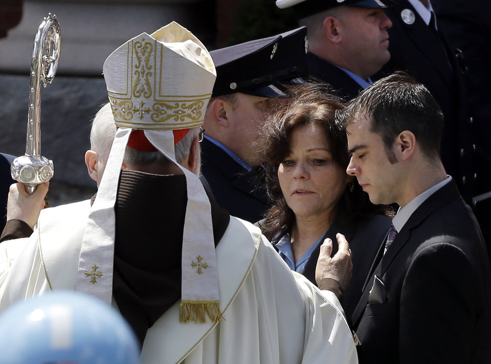 Boston Cardinal Sean O\'Malley comforts Patty Campbell and her son, Billy, after a funeral for her daugher, Krystle Campbell, 29, at St. Joseph\'s Church in Medford, Mass. Monday, April 22, 2013. Krystle Campbell is one of three victims killed in the Boston Marathon explosions. (AP Photo/Elise Amendola)