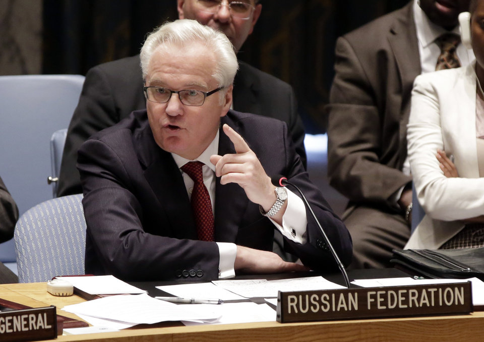 Photo - FILE - Russian Federation Ambassador Vitaly Churkin addresses the United Nations Security Council,  in this May 2, 2014 file photo. Russia's U.N. ambassador said Thursday June 26, 2014 there is a real prospect of a terrorist state springing up from Syria's second-largest city Aleppo to Iraq's capital Baghdad.  (AP Photo/Richard Drew, File)