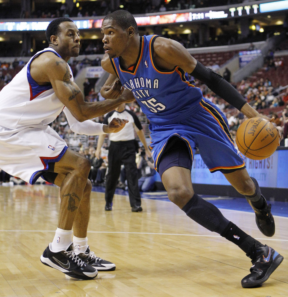 Photo - Oklahoma City Thunder's Kevin Durant, right, drives to the basket around Philadelphia 76ers' Andre Iguodala in the first half of an NBA basketball game, Tuesday, March 30, 2010, in Philadelphia. (AP Photo/Matt Slocum) ORG XMIT: PXC101