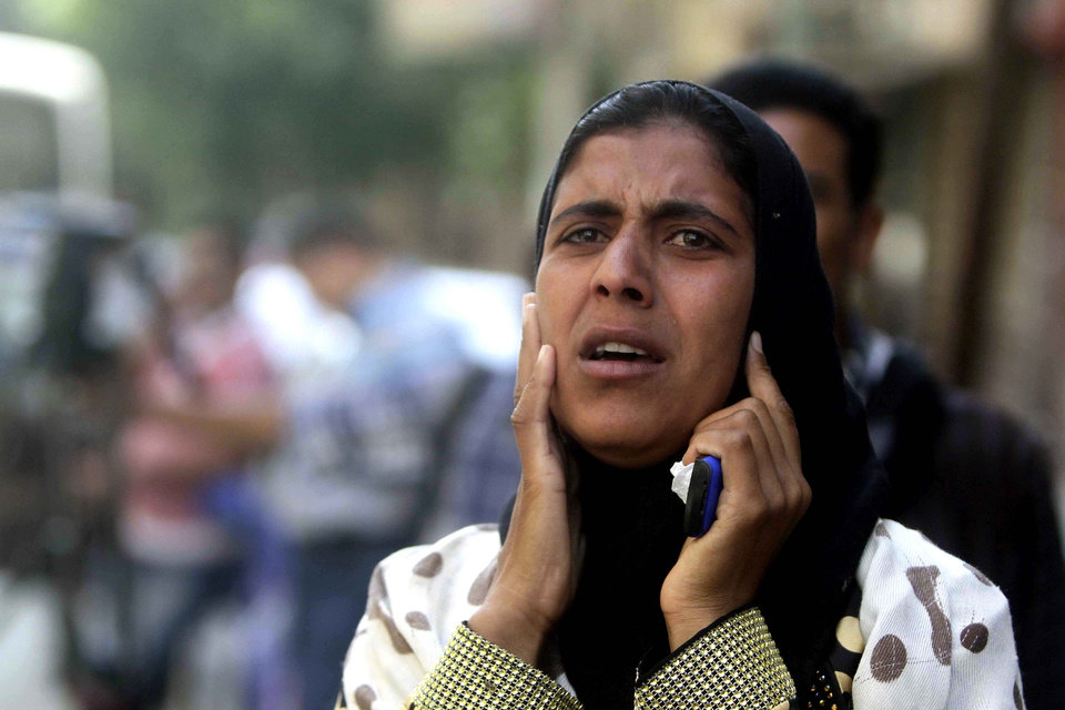 Photo - A relative of a Muslim Brotherhood member who was sentenced to death reacts to the verdict outside a courtroom in Minya, Egypt, Saturday, June 21, 2014. The Muslim Brotherhood's spiritual leader and over 180 others were sentenced to death Saturday by an Egyptian court in the latest mass trial following last year's overthrow of the country's Islamist president. The ruling by the southern Minya Criminal Court is the largest confirmed mass death sentence to be handed down in Egypt in recent memory. The court acquitted more than 400 others in the case and family members of the accused wailed or cheered the verdicts. (AP Photo/Ravy Shaker, El Shorouk newspaper)    EGYPT OUT
