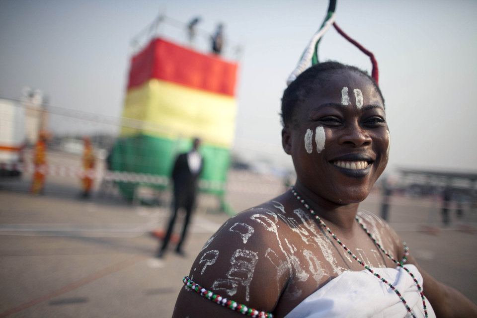 Photo - A Ghanaian woman arrives at Independence Square hours ahead of the inauguration ceremony of President-elect John Dramani Mahama, in Accra, Ghana, Monday, Jan. 7, 2013. Mahama became president of Ghana on Monday, sworn in as the opposition continues to dispute election results in one of West African's most stable democracies. (AP Photo/Gabriela Barnuevo)