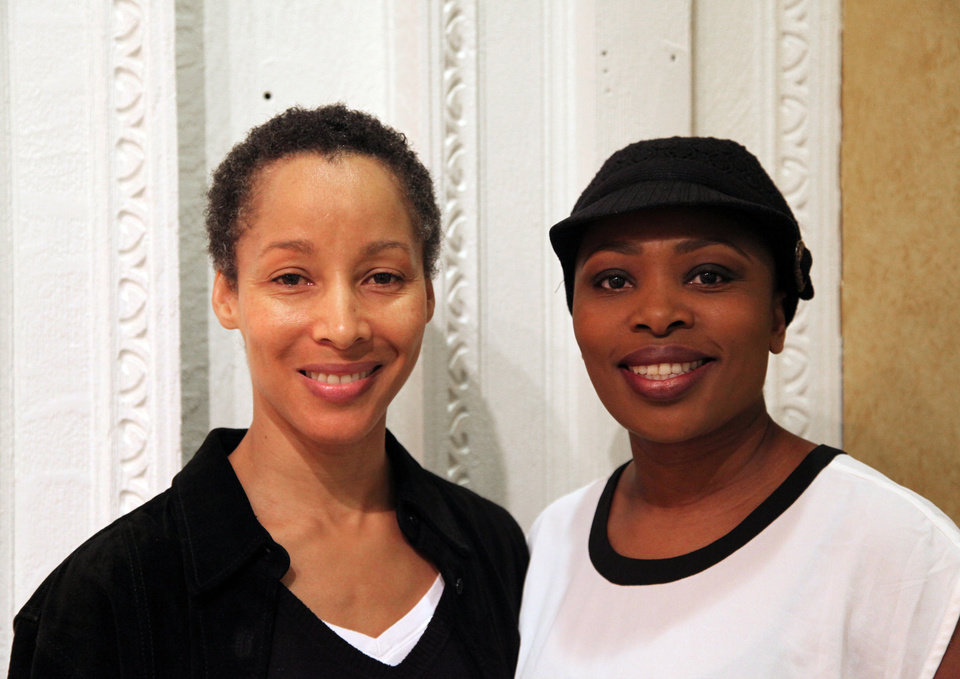 In this Nov. 8, 2012, photo, dancer Camille N. Brown, left, and singer Lindiwe Dlamini pose before a performance of �The Lion King� in New York. Both women have been in the ensemble of the Broadway hit show for its entire 15-year run. (AP Photo/Mark Kennedy)