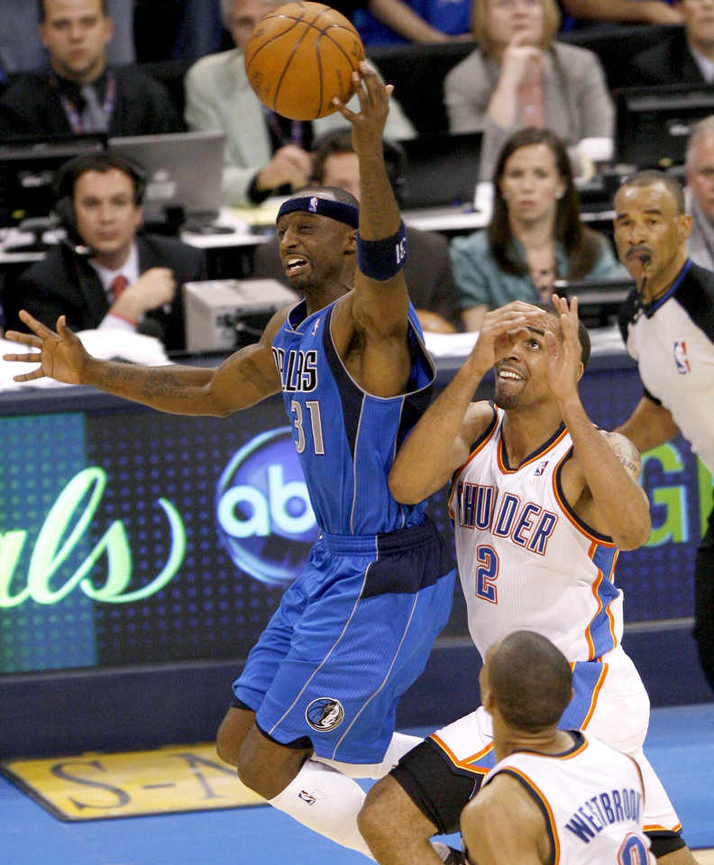 Photo - Jason Terry (31) of Dallas leaps in front of Oklahoma City's Thabo Sefolosha (2) for the ball during game 4 of the Western Conference Finals in the NBA basketball playoffs between the Dallas Mavericks and the Oklahoma City Thunder at the Oklahoma City Arena in downtown Oklahoma City, Monday, May 23, 2011. Dallas won in overtime, 112-105. Photo by Bryan Terry, The Oklahoman