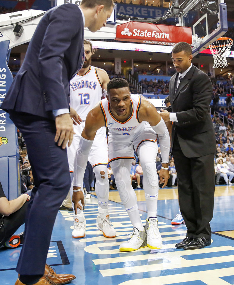 Photo - Oklahoma City's Russell Westbrook (0) tries to walk off on his own after being injured in the third quarter during an NBA basketball game between the Oklahoma City Thunder and the New Orleans Pelicans at Chesapeake Energy Arena in Oklahoma City, Monday, Nov. 5, 2018. Oklahoma City won 122-116. Photo by Nate Billings, The Oklahoman