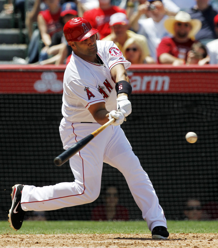Los Angeles Angels' Albert Pujols hits a two-run home run against the Toronto Blue Jays during the fifth inning of a baseball game in Anaheim, Calif., Sunday, May 6, 2012. This was Pujols' first home run of the season. (AP Photo/Chris Carlson)