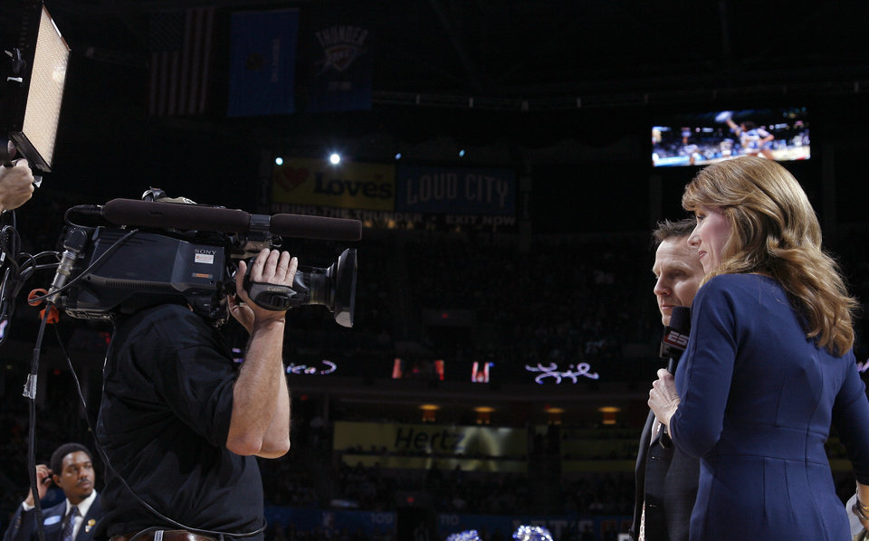 Photo - Sideline reporter Heather Cox interviews Oklahoma City head coach Scott Brooks during a timeout at the NBA basketball game between Oklahoma City and Miami at the OKC Arena in Oklahoma City, Thursday, Jan. 30, 2011. Photo by Sarah Phipps, The Oklahoman