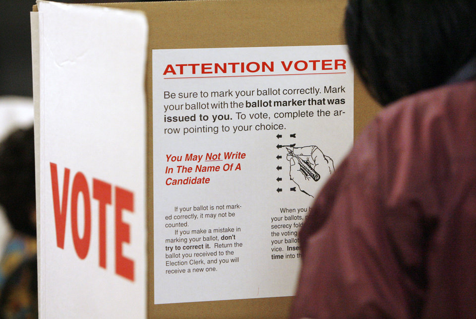 Photo - Instructions to voters as a voter marks her ballot in a voting booth at precinct 551, Millwood High School, in Oklahoma City Tuesday, Nov. 4, 2008.  BY PAUL B. SOUTHERLAND, THE OKLAHOMAN