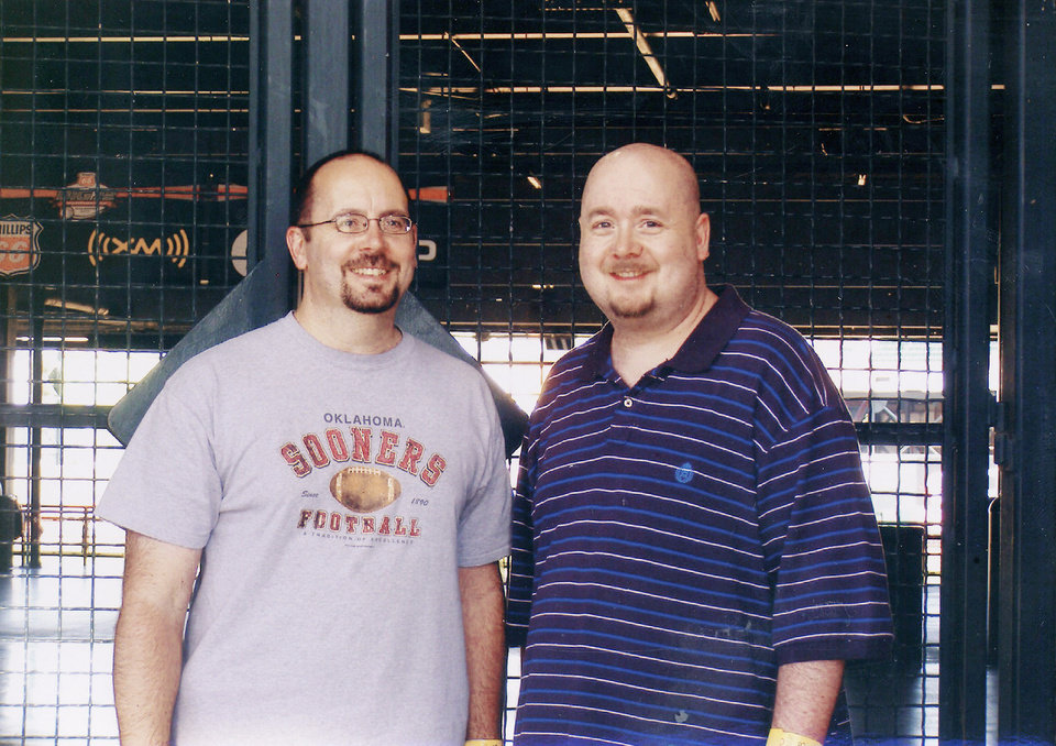 I look massive beside my brother, Ron, at the Bricktown Ballpark last summer. He's the handsome devil on the left.