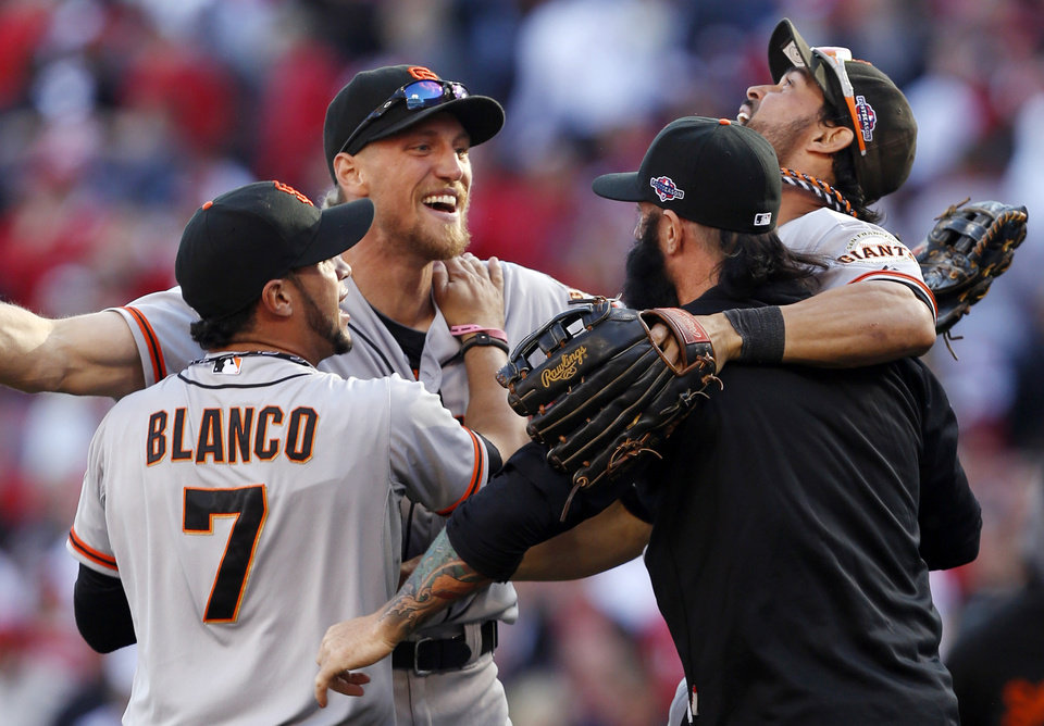 Photo -   San Francisco Giants', from left, Gregor Blanco, Hunter Pence, Brian Wilson, and Angel Pagan celebrate after they defeated the Cincinnati Reds 6-4 in Game 5 of the National League division baseball series, Thursday, Oct. 11, 2012, in Cincinnati. The Giants won the final three games, all in Cincinnati, and advanced to the NL championship series. (AP Photo/David Kohl)