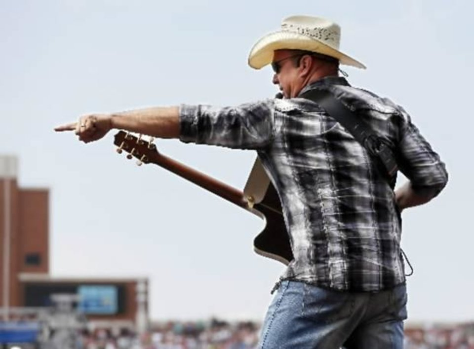 Photo -  Garth Brooks performs during the Oklahoma Twister Relief Concert, benefiting victims of the May tornadoes, at Gaylord Family - Oklahoma Memorial Stadium on the campus of the University of Oklahoma in Norman, Okla., Saturday, July 6, 2013. Photo by Nate Billings, The Oklahoman Archive