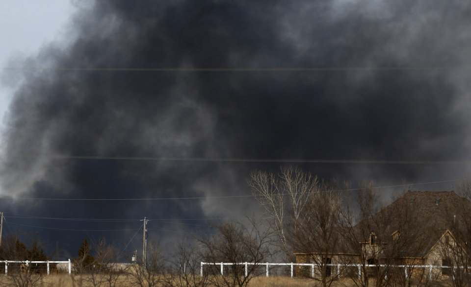 Photo - Smoke from a wildfire near SE 164th and Air Depot builds in southeast Oklahoma City, Okla., Sunday, Feb. 12, 2017. Photo by Sarah Phipps, The Oklahoman