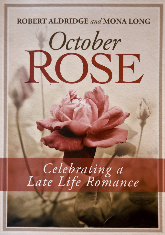 Photo - The book 'October Rose' written by dating couple Bob Aldridge and Mona Long in Edmond, Okla. on Tuesday, Feb. 3, 2015. The book is a celebration of late life romance.  Photo by Chris Landsberger, The Oklahoman   	L