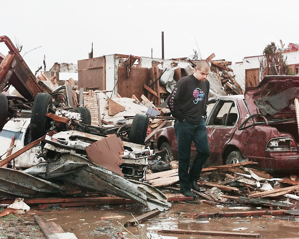 MAY 3, 1999 TORNADO: Tornado victims, damage: Area of NW 27TH AND I-35 IN MOORE OKLA.  Steven Johnson looks over damage to his house at 2520 Ridgewood  (Nolans Clay's housing addition Highland Park) Just south of the First Baptist Church.  Steven and his family lost three houses in the area.