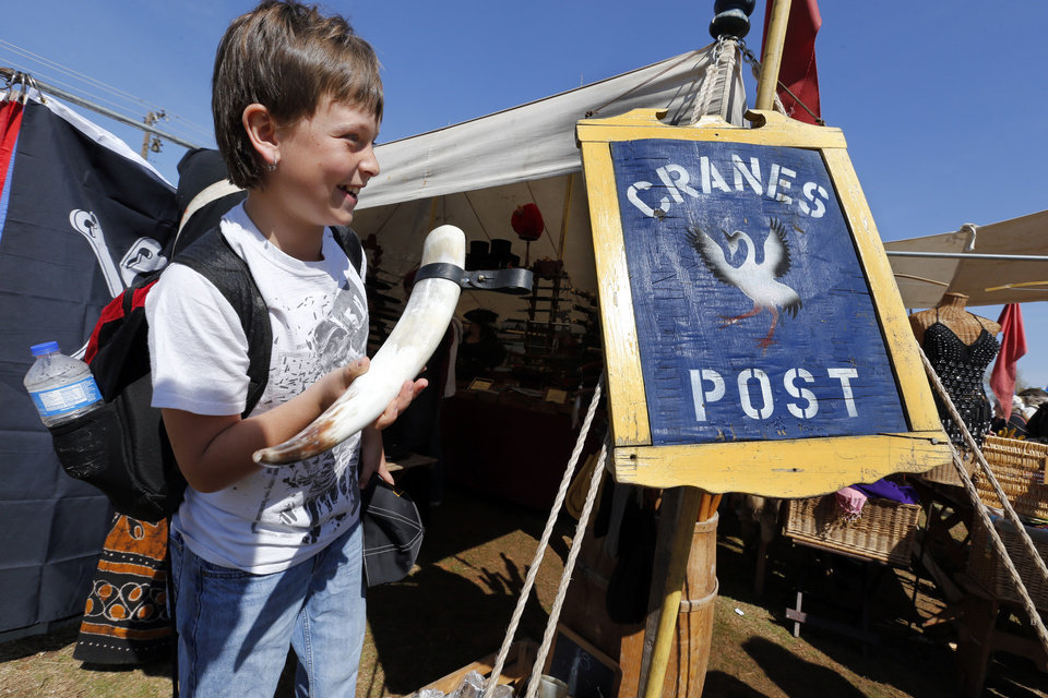 Dakota Reed, Ninnekah sixth grade student, checks out merchandise during the Medieval Fair at Reaves Park on Friday, April 5, 2013 in Norman, Okla. Photo by Steve Sisney, The Oklahoman