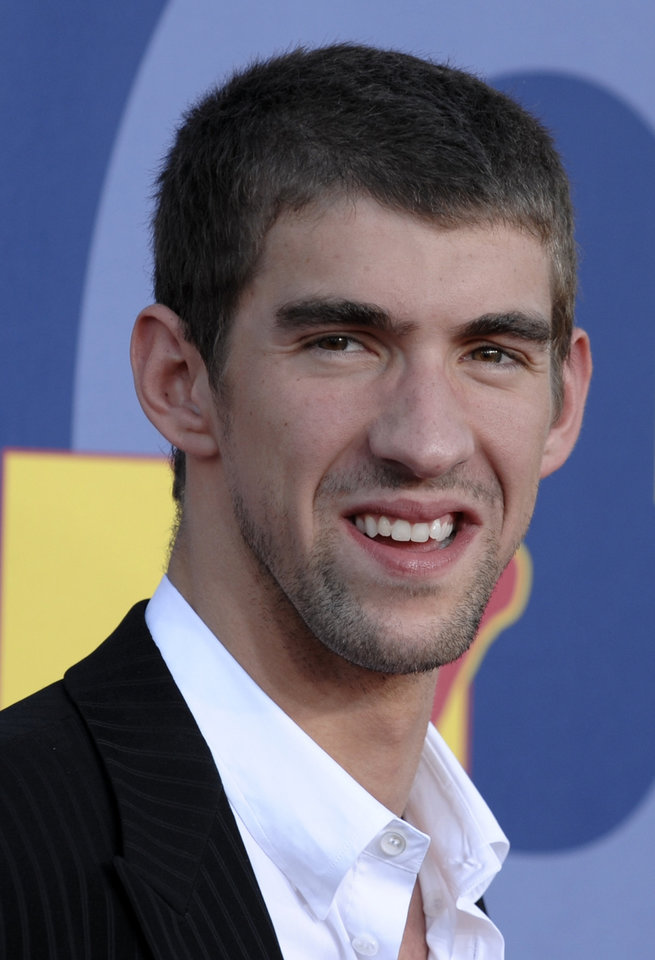 Photo - ** FILE ** In this Sept. 7, 2008 file photo, Michael Phelps arrives at the 2008 MTV Video Music Awards held at Paramount Pictures Studio Lot  in Los Angeles.  Phelps takes a break from rehearsals to discuss his weekend gig hosting the season premiere of