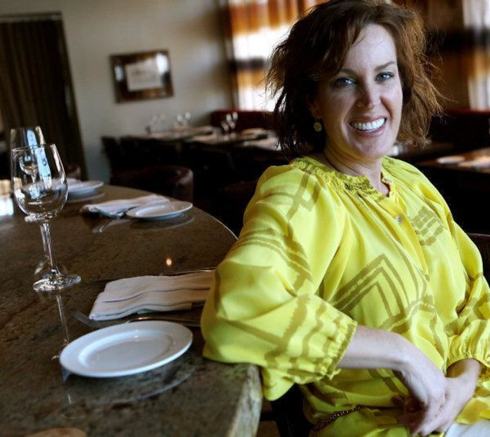 Owner Lori Tyler sits inside Stella Modern Italian Cuisine in Oklahoma City. Photo by John Clanton, The Oklahoman <strong>John Clanton</strong>