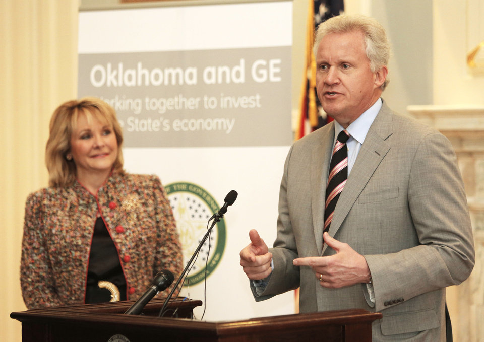 Photo - Gov. Mary Fallin listens as GE Chairman and CEO Jeff Immelt announces the company's plans for a $110 million global research center in Oklahoma during a news conference Wednesday at the state Capitol. PHOTO BY STEVE GOOCH, THE OKLAHOMAN