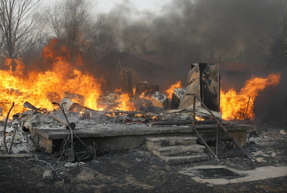A burned home was in the path of wildfires which destroyed 12 structures in Lindsay, Okla., on Thursday, April 9, 2009. Photo by Steve Sisney, The Oklahoman