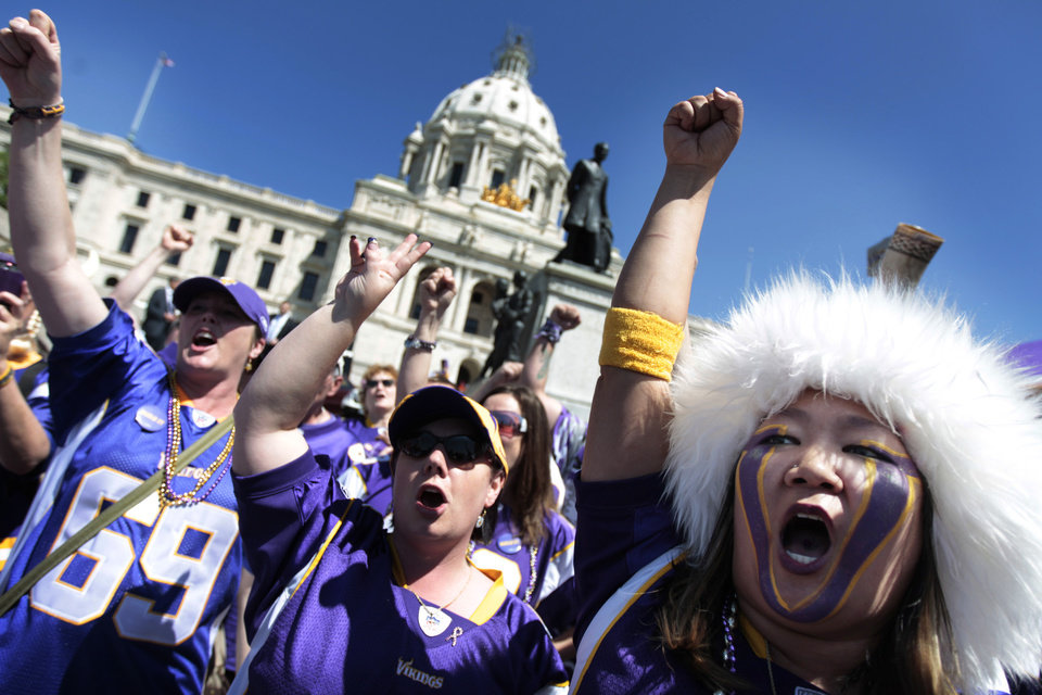 Photo -   Minnesota Vikings fan Erin Darsow, right, of Burnsville, Minn., attens a rally at the state Capitol in support of a new stadium for the NFL football team, Monday, May 7, 2012, in St. Paul, Minn. Supporters of a new Vikings stadium pleaded for votes in the Minnesota House on Monday, calling it their
