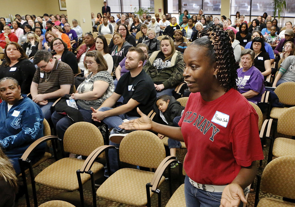 Photo - Rochelle Smith, Oklahoma City, works at a home day care and provides the panel with concerns from that perspective. She is with Tender Child Care. About 200  child care providers attended a public forum at Francis Tuttle Technology Center, Reno campus, to  voice their concerns with DHS regulators during a 2-hour session Tuesday afternoon, Nov. 27, 2012.  Photo by Jim Beckel, The Oklahoman