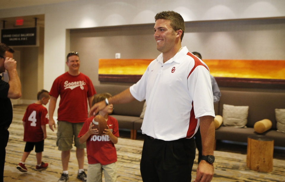 Photo - University of Oklahoma quarterback Blake Bell meets fans at the Sooner Caravan at the Hyatt Wichita. Bell was there with head coach Bob Stoops and a few other coaches. Bell is a Wichita native and Bishop Carroll graduate. (June 19, 2013) Photo by Jaime Green, The Wichita Eagle ORG XMIT: B73183861Z.1