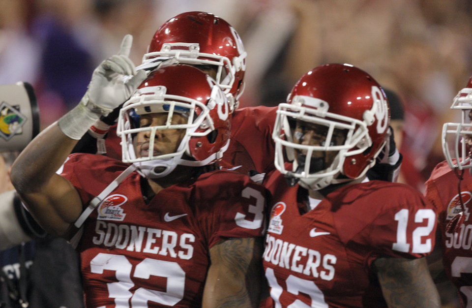 Oklahoma's Jamell Fleming (32) celebrates an interception with Tony Jefferson (12) during the Insight Bowl college football game between the University of Oklahoma (OU) Sooners and the Iowa Hawkeyes at Sun Devil Stadium in Tempe, Ariz., Friday, Dec. 30, 2011. Photo by Sarah Phipps, The Oklahoman