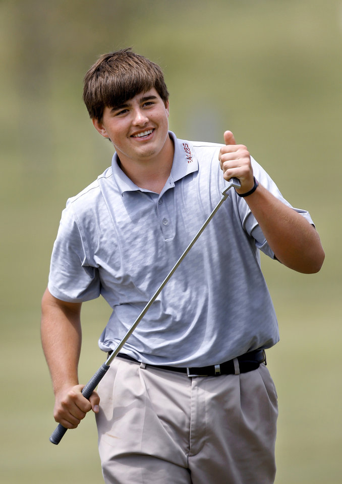 Photo - Weatherford High School golfer Quade Cummins smiles as he walks off the 18th green after sinking a putt to complete his round in the Class 4A boy's state golf  tournament on Tuesday, May 7, 2013,  at  Hefner Golf Course in Oklahoma City.   Photo  by Jim Beckel, The Oklahoman.