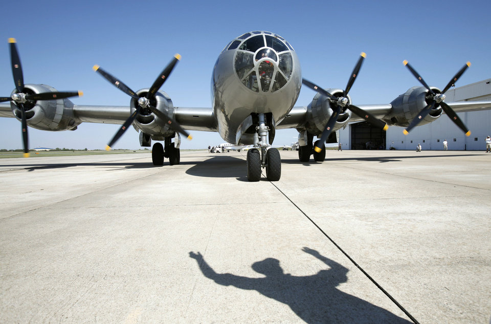 Photo - The last airworthy B-29 Superfortress comes to a stop after flying into Wiley Post Airport in Oklahoma City, OK, Tuesday, October 2, 2012. It will be on exhibit for six days at Wiley Post Airport.  By Paul Hellstern, The Oklahoman