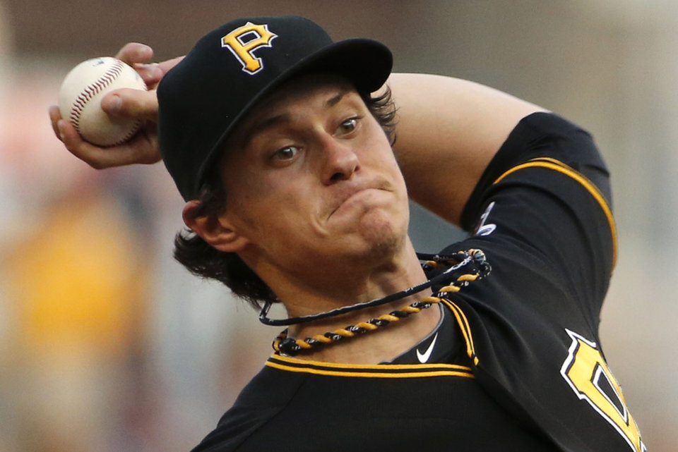 Photo - Pittsburgh Pirates starting pitcher Jeff Locke delivers during the first inning of a baseball game against the Miami Marlins in Pittsburgh on Wednesday, Aug. 6, 2014. (AP Photo/Gene J. Puskar)