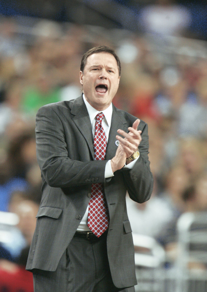 Photo - NCAA TOURNAMENT: University of Kansas head coach Bill Self calls to his team during an NCAA Midwest Regional semifinal college basketball game against Villanova Friday, March 28, 2008, in Detroit. (AP Photo/Duane Burleson) ORG XMIT: OTKMD113