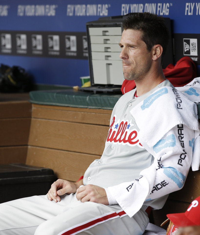 Photo - Philadelphia Phillies starting pitcher Cliff Lee sits in the dugout during the second inning of an opening day baseball game against the Texas Rangers at Globe Life Park, Monday, March 31, 2014, in Arlington, Texas.  (AP Photo/Tony Gutierrez)