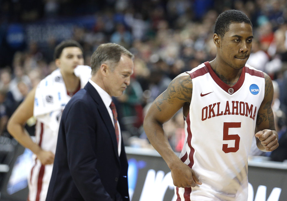 Photo - Oklahoma's Je'lon Hornbeak (5) walks off the court following the Sooner's loss to North Dakota State at the NCAA men's basketball tournament at the Spokane Arena in Spokane, Wash., Thursday, March 20, 2014. Oklahoma home lost 80-75. Photo by Sarah Phipps, The Oklahoman