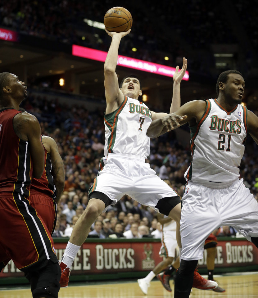 Photo - Milwaukee Bucks' Ersan Ilyasova (7) shoots during the second half of Game 3 in their first-round NBA basketball playoff series against the Miami Heat, Thursday, April 25, 2013, in Milwaukee. (AP Photo/Morry Gash)