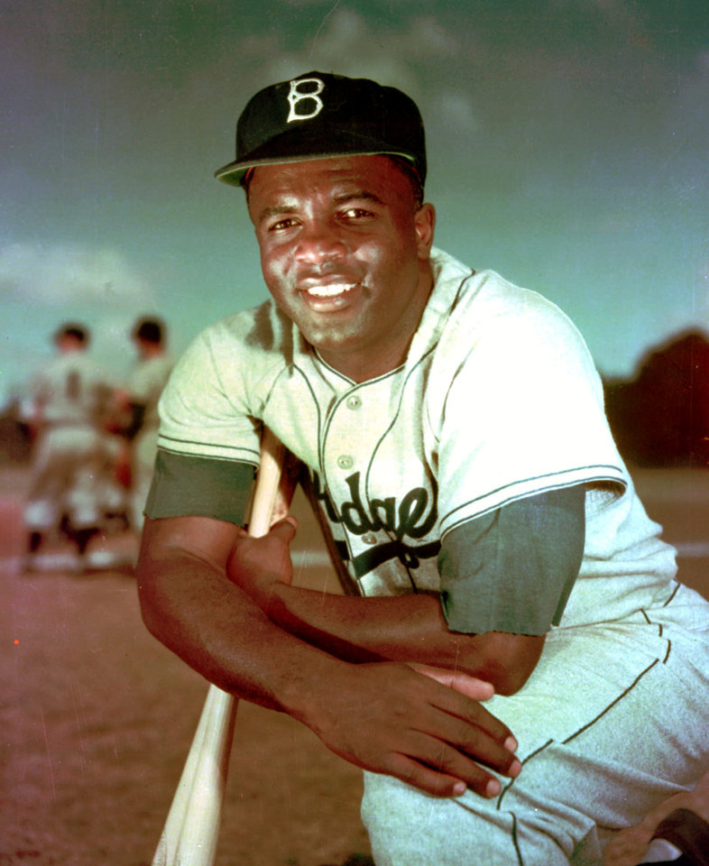 Photo - FILE - Brooklyn Dodgers baseball player Jackie Robinson poses in 1952. Kansas City's Negro Leagues Baseball Museum is hosting an advance screening of an upcoming movie about Robinson, who broke major league baseball's color barrier. Thomas Butch of the financial firm Waddell and Reed announced Wednesday, March 20, 2013 that actors Harrison Ford and Andre Holland will be among those appearing at an April 11 screening of