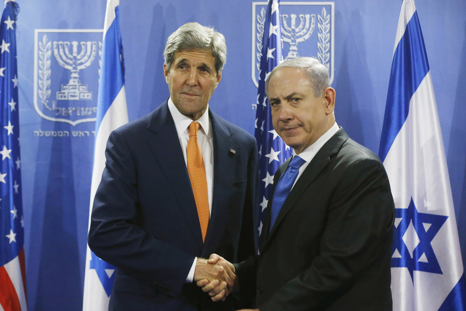 Photo - U.S. Secretary of State John Kerry, left, meets with Israeli Prime Minister Benjamin Netanyahu in Tel Aviv, Israel, Wednesday, July 23, 2014. Kerry flew into Tel Aviv despite a Federal Aviation Administration ban following a Hamas rocket that hit near the airport the day before, reflecting his determination to achieve a cease-fire agreement between the warring sides. (AP Photo/Pool)