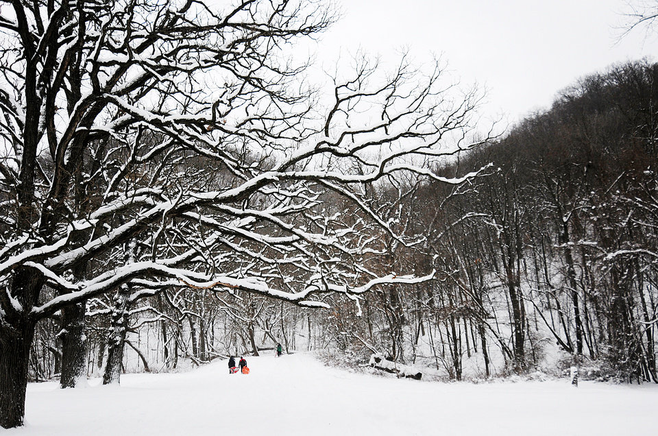 Photo - Children make their way up the hill at Bluffside Park while sledding Thursday, Dec. 20, 2012, in Winona, Minn. (AP Photo/Winona Daily News, Joe Ahlquist)