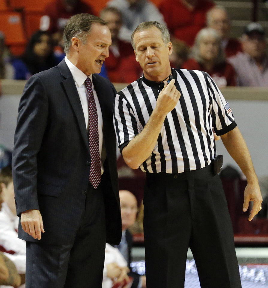 Oklahoma coach Lon Kruger has a talk with the official during the NCAA college basketball game between the University of Oklahoma Sooners (OU) and the University of Kansas (KU) Jayhawks at Lloyd Nobel Center in Norman,  Okla. on Wednesday, Jan. 8, 2014.   .Photo by Chris Landsberger, The Oklahoman