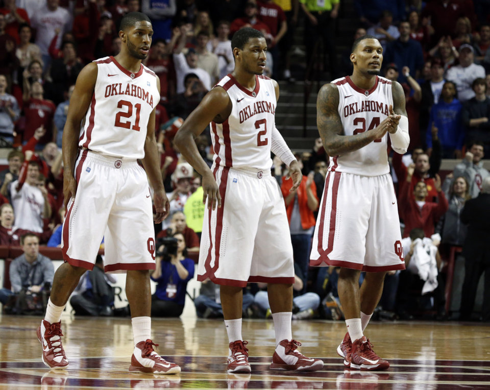 Oklahoma's Cameron Clark (21), Steven Pledger (2) and Romero Osby (24) wait at mid court as a teammate shoots free throws to close out he second half as the University of Oklahoma Sooners (OU) defeat the Kansas Jayhawks (KU) 72-66 in NCAA, men's college basketball at The Lloyd Noble Center on Saturday, Feb. 9, 2013 in Norman, Okla. Photo by Steve Sisney, The Oklahoman