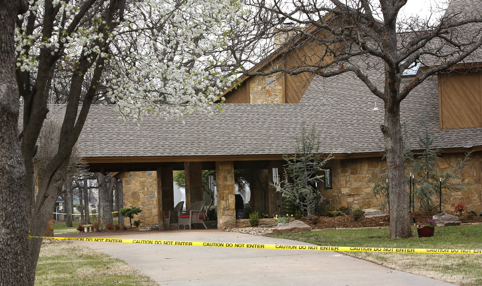 Shawnee police investigate the scene of a pre-dawn homicide in an upscale neighborhood in northeast Shawnee Thursday, March 21, 2013.  Police confirmed that Cathy Byus was killed in a domestic-related homicide inside her home at 27 Bella Vista Vista Lane.   Photo by Jim Beckel, The Oklahoman