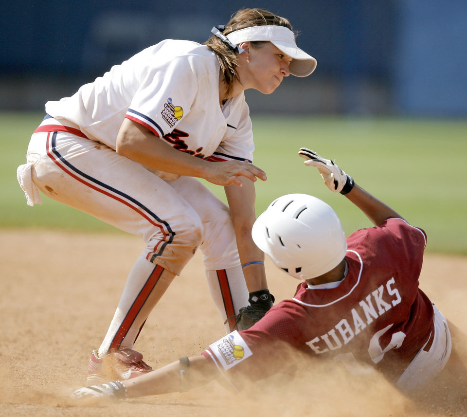 Photo - Arizona's K'Lee Arredondo tags out Alabama's Kellie Eubanks at second base in the seventh inning of the Women's College World Series game between Alabama and Arizona at ASA Hall of Fame Stadium in Oklahoma City, Saturday, May 31, 2008. BY BRYAN TERRY, THE OKLAHOMAN