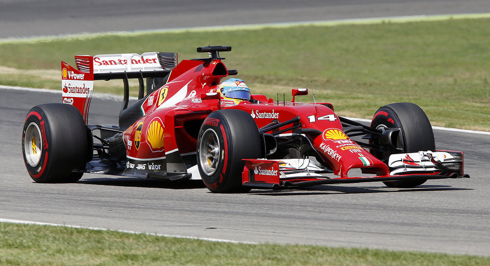 Photo - Ferrari driver Fernando Alonso of Spain races during the qualifying of the German Formula One Grand Prix in Hockenheim, Germany, Saturday, July 19, 2014. The German Grand Prix will be held on Sunday.(AP Photo/Michael Probst)