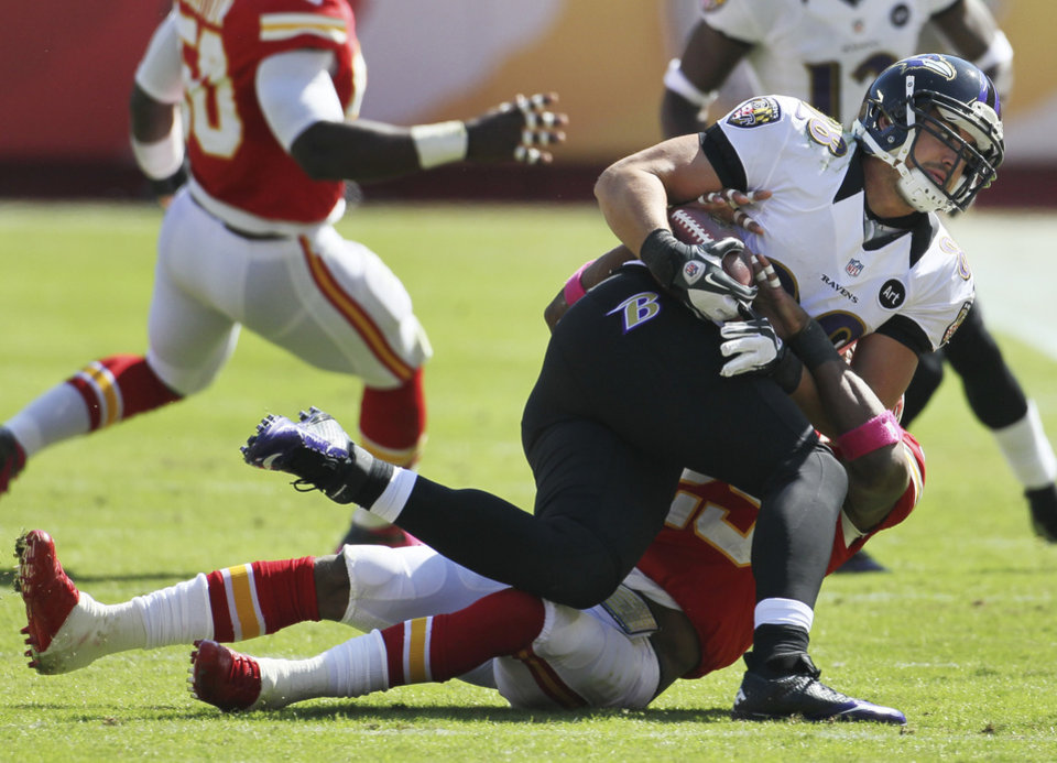 Photo -   Baltimore Ravens tight end Dennis Pitta (88) is tackled by Kansas City Chiefs strong safety Eric Berry (29) during the first half of an NFL football game at Arrowhead Stadium in Kansas City, Mo., Sunday, Oct. 7, 2012. (AP Photo/Charlie Riedel)
