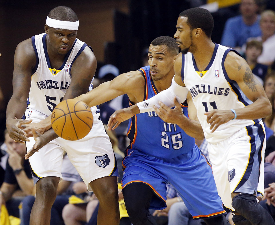 Photo - Oklahoma City's Thabo Sefolosha (25) tries to steal the ball from Memphis' Zach Randolph (50) next to Mike Conley (11) during Game 4 in the first round of the NBA playoffs between the Oklahoma City Thunder and the Memphis Grizzlies at FedExForum in Memphis, Tenn., Saturday, April 26, 2014. Photo by Bryan Terry, The Oklahoman