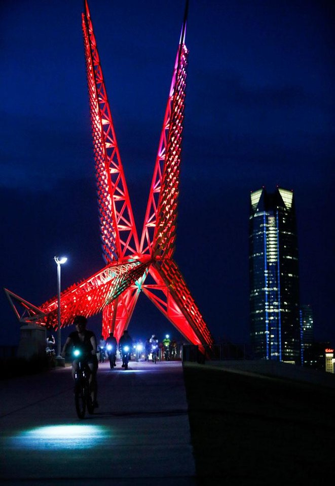 Cyclists pass over the SkyDance bridge during the Full Moon Bicycle Ride organized by the Myriad Gardens and Schlegel Bicycles in Oklahoma City, Monday, July 22, 2013. Photo by Nate Billings, The Oklahoman