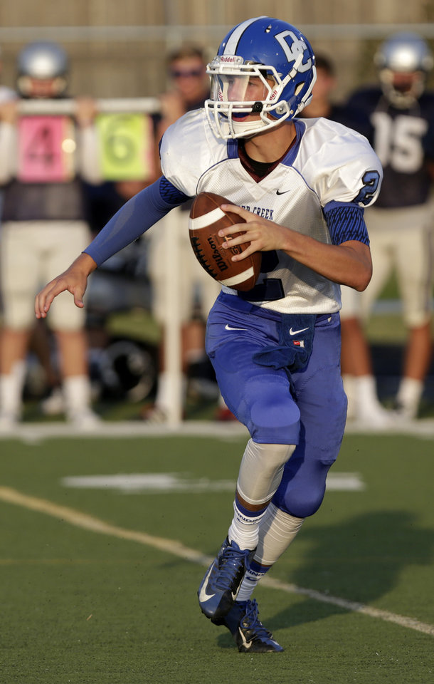 Photo - Deer Creek's Julian Hoskins (2) looks for a pass during a scrimmage at Putnam City West High School in Bethany, Thursday, Aug. 21, 2014.  Photo by Garett Fisbeck, For The Oklahoman