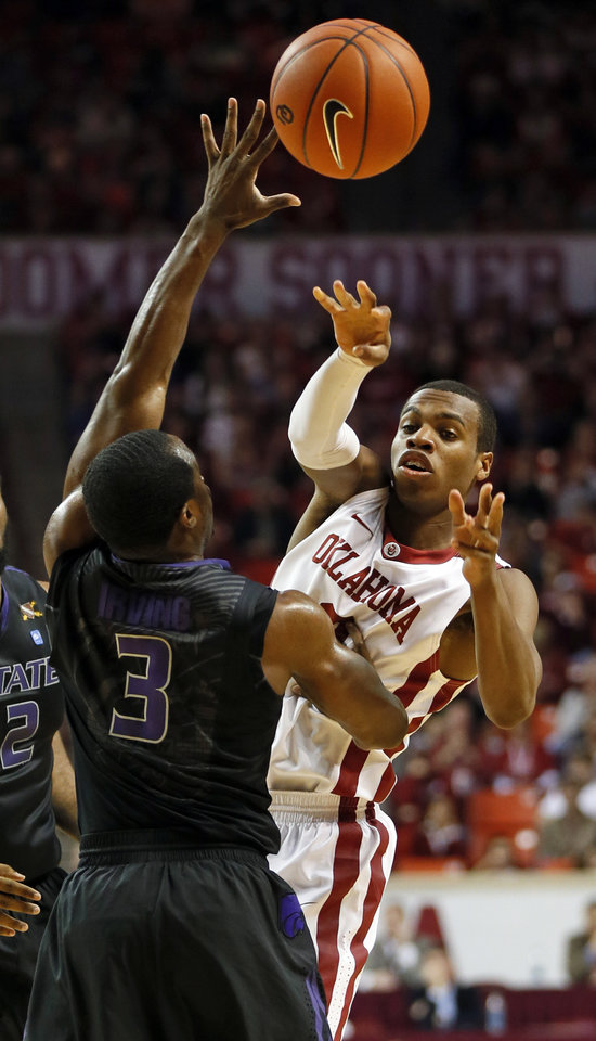 Oklahoma's Buddy Hield (3) passes the ball around Kansas State's Martavious Irving (3) during an NCAA men's basketball game between the University of Oklahoma (OU) and Kansas State at the Lloyd Noble Center in Norman, Okla., Saturday, Feb. 2, 2013. Photo by Nate Billings, The Oklahoman