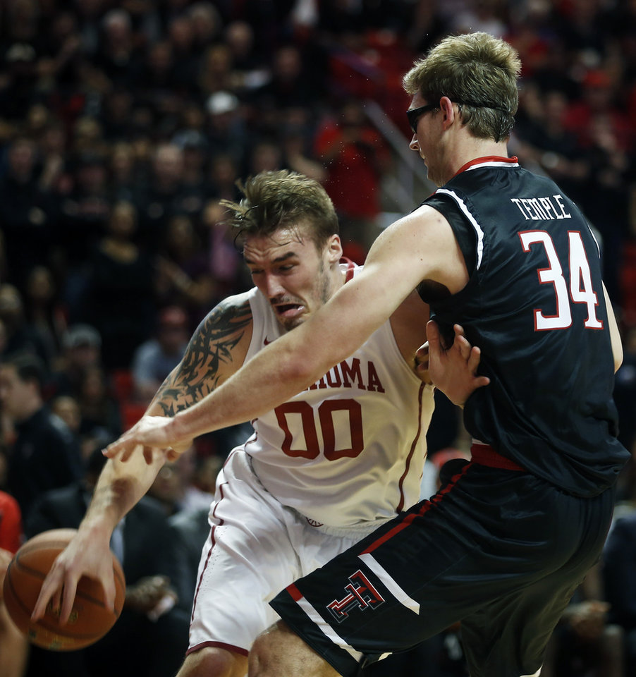 Photo - Oklahoma's Ryan Spangler tries to dribble the ball past Texas Tech's Matthew Temple during the first half of an NCAA college basketball game on Wednesday, Feb. 17, 2016 in Lubbock, Texas. (AP Photo/Brad Tollefson)