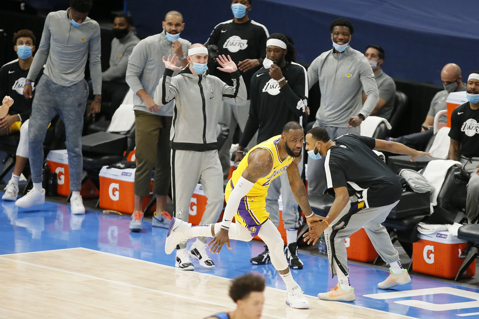 Photo - LeBron James (23) celebrates after a dunk during an NBA basketball game between the Oklahoma City Thunder and the Los Angeles Lakers at Chesapeake Energy Arena in Oklahoma City, Wednesday, Jan. 13, 2021.  San Antonio won 112-102. [Bryan Terry/The Oklahoman]