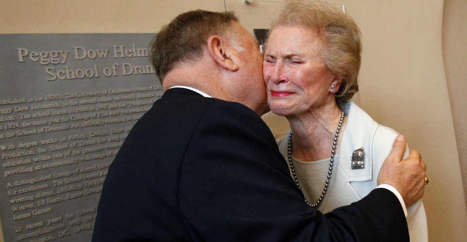 Photo - HONOR / DEDICATE / DEDICATED: Tulsa civic leader and community volunteer Peggy Dow Helmerich is honored with a plaque dedication by the University of Oklahoma at Rupel Jones Theater on Wednesday, Sept. 26, 2012 in Norman, Okla.  She receives a kiss from OU President David Boren.  Helmerich's acting career included performances in